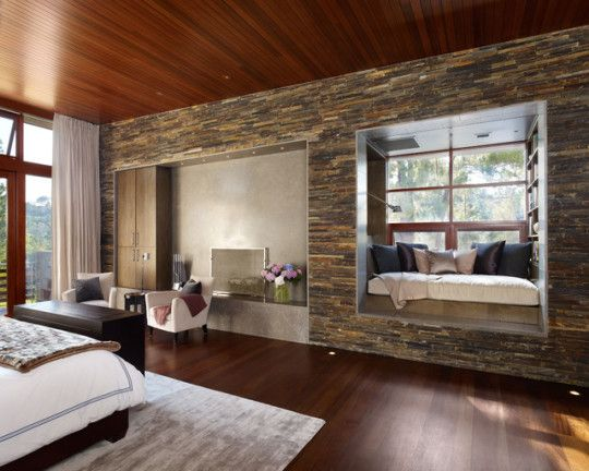Bedroom #reading #nook by Rockefeller Partners Architects.  The stone extension jamb forms an entire reading alcove, a part of the contemporary and stylish bedroom.