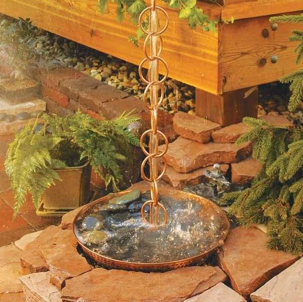 Love this Rain Chain and the idea of it landing in a dish that drains out! Would be so cool to listen to while it's raining!