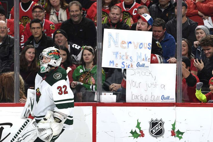 CHICAGO, IL - DECEMBER 17: Fans hold up signs during the game between the Chicago Blackhawks and the Minnesota Wild at the United Center on December 17, 2017 in Chicago, Illinois. (Photo by Bill Smith/NHLI via Getty Images)