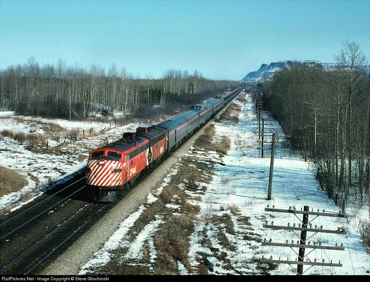 """CPR train number 1, the """"Canadian"""" heads west from Thunder Bay en route to Winnipeg and Vancouver. This location is known as """"Dexter."""" April 1975"""