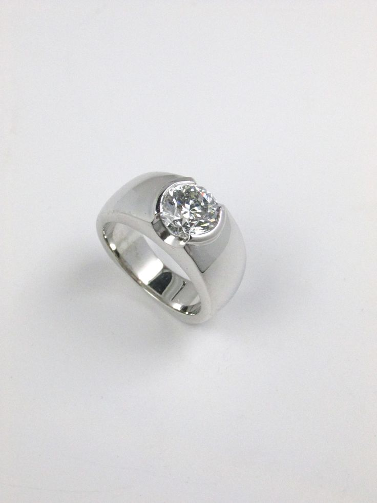 1.80 Ct diamond engagement ring in a modern setting with a semi bezel.  Wide engagement ring.  Custom made at Redford Jewelers in Salt Lake City