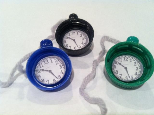 """Pocket watch SWAPS for """"Alice in Wonderland"""" themed camp weekend. My troop made these using plastic bottle caps from sodas and water. We glued a pony bead on top with a piece of yarn, a clock face and a pin back. We attached a card saying, """"We're late, we're late, for very important date. No time to say hello, good bye, I'm late, I'm late, I'm late!"""""""