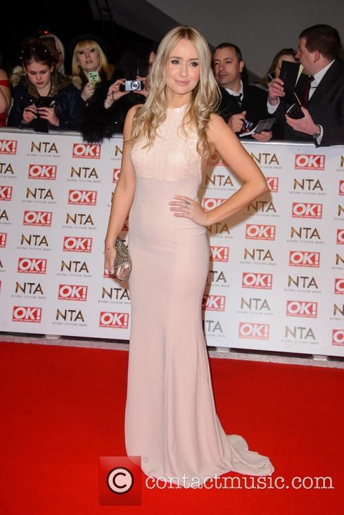 Sammy Winward wearing a floor length,, sleevelsss pink dres at the National Television Awards