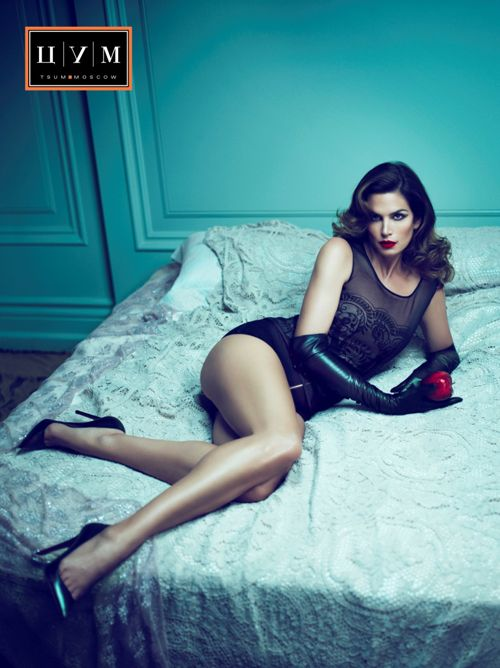 CINDY CRAWFORD (at 44) lying on the bed. This photo was ...