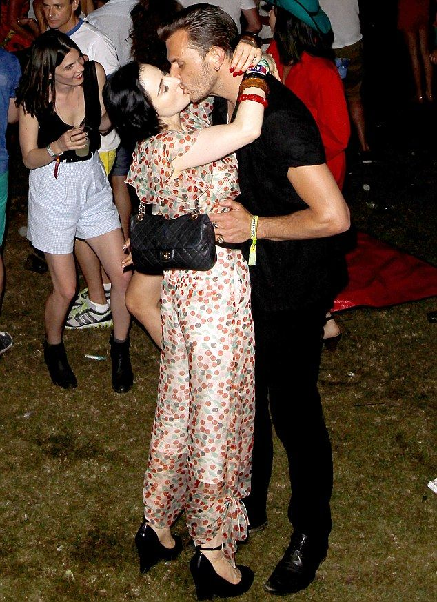 Loved up: Gorgeous burlesque model Dita Von Teese kisses Hurts frontman Theo Hutchcraft during the Swedish House Mafia's set at the Coachella Music Festival in Indio