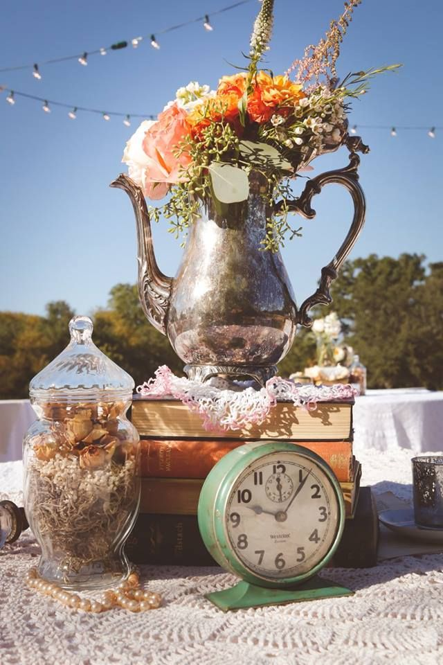 Teapot, books, teacup, clock, table decor for retro Tea party wedding by Rent My Dust, silver teapot from rentmydust.com