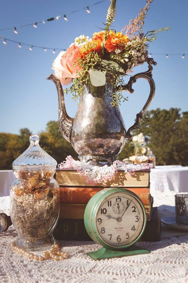 Teapot, books, teacup, clock, table decor for retro Tea party wedding by Rent My Dust, silver teapot.  Tea Party Garden Wedding