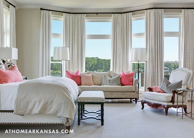 Brun sought a hotel-like serenity in the master bedroom. The sofa is by Bernhardt, and the armchairs brought in form the great room have new life in the master bedroom. | Rooms With A View | At Home in Arkansas | July 2016 | Bedroom | Coral | White | Neutral