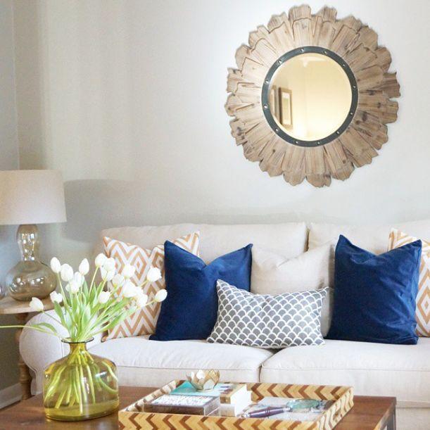 Round mirror over sofa