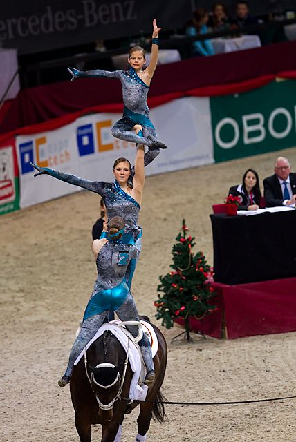 Equestrian Vaulting... did this for two years my favorite horse sport by far to watch and participate!!!