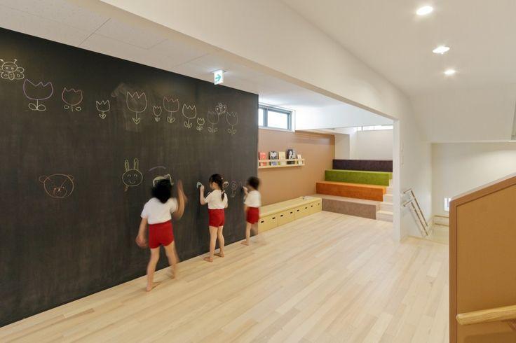 OB Kindergarten and Nursery / HIBINOSEKKEI + Youji no Shiro, chalkboard wall, wood floors, forum seating, cubbies