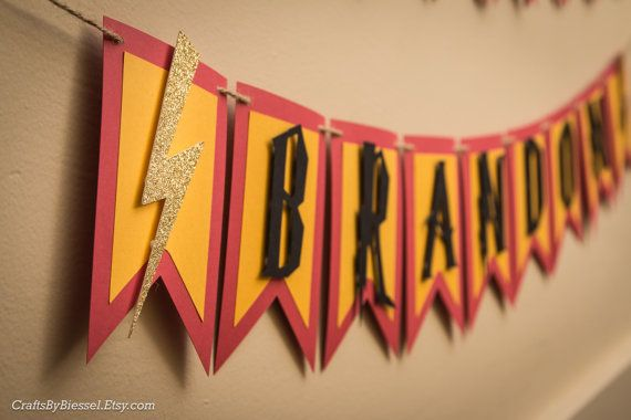 Created with attention to detail and handmade with love, this adorable Harry Potter inspired birthday banner is the perfect touch for your Wizard party celebration!  The Happy Birthday banner, framed with a sorting hat on either side measures 6 feet long and is made with the Gryffindor colors - yellow, red, brown, and black. Each flag measures 6 x 4.25. The letters, sorting hats, and lightning bolts are all raised off the cardstock for a popping multidimensional look! The banner comes…