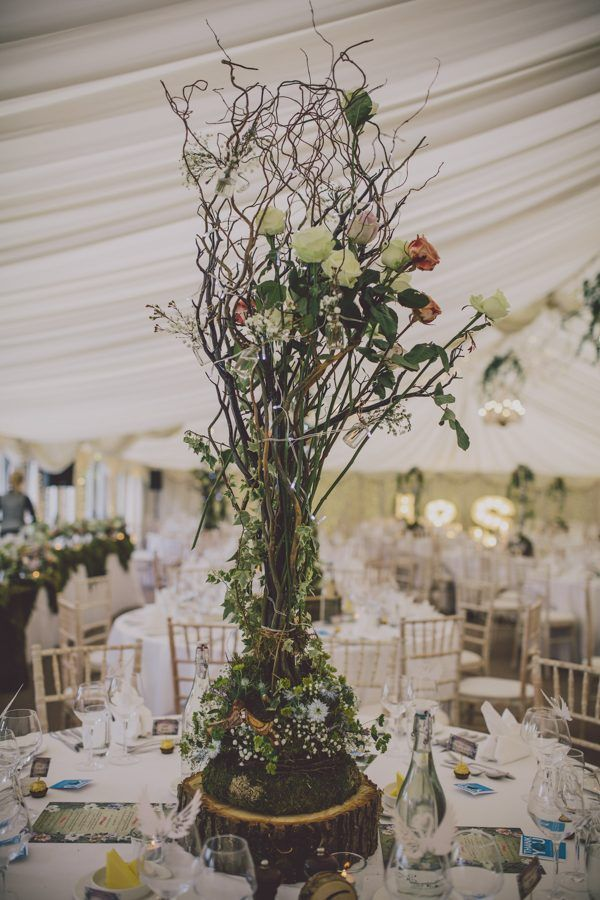 Tall woodsy centerpiece | Image by Ten21 Photography