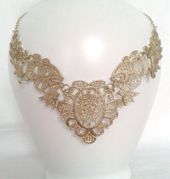 Detailed Gold Metal Bib Necklace by LilyAndEllie.com, $20.00
