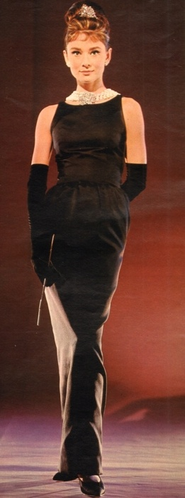 """Audrey Hepburn in a Givenchy satin evening gown aka the most famous """"little black dress"""" of all time."""