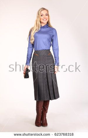 business woman in blue blouse and long skirt and boots full body length high heeled wellingtons shoes back shot isolated on white