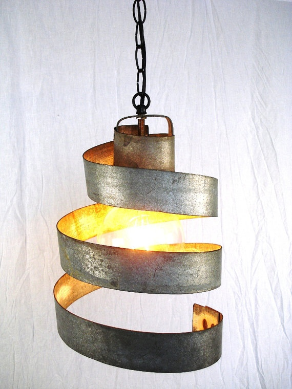 This hanging light is made from the metal trim on wine barrels.
