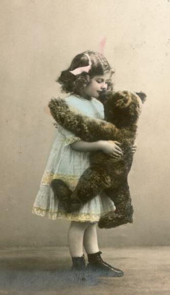 Little girl with her huge teddy (vintage postcard)