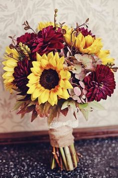 Dramatic Burgundy and Sunflower Bouquet - Warmth and Happiness: 20 Perfect Sunflower Wedding Bouquet Ideas - EverAfterGuide