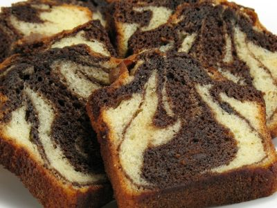 Authentic recipe for German Marble Cake: Marmorkuchen.  Will try making this with a little almond extract added to the vanilla portion and a few tbsps of dark rum added to the chocolate bit.