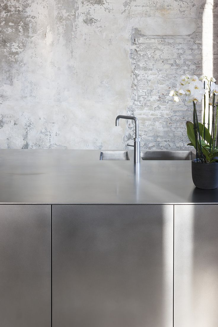+ Chrome kitchen meets worn wall ...