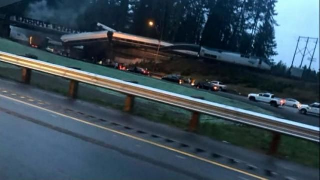 Video: Train derails in Washington state, leaving car dangling over highway