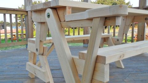 This all in one picnic table and bench is diy at it s for Flip top picnic table plans