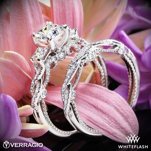 This 3 Stone Engagement Ring is from the Verragio Insignia Collection. It features 0.55ctw of princess and round brilliant-cut diamonds to enhance a princess cut diamond center.