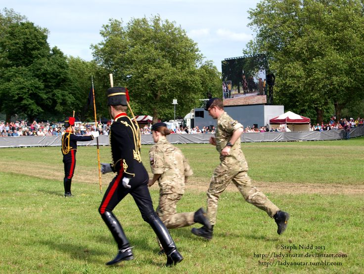 Military Personnel and a member of the King's Troop getting ready for a display