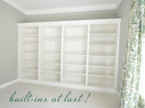 """Cost: four 15"""" deep Billy bookcases at $69 each ($300 with tax), plus plywood, crown molding and trim: $65  Total = $365   * update: many asked about paint colors. The wall color is 'Camouflage' by Benjamin Moore and the paint on the trim on the bookcases is Valspar's 'Dove White'. Valspar's 'Cream Delight' and 'Ivory Dust' are also very close matches to the IKEA white."""