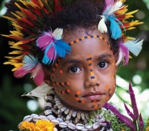 The kids in PNG are lovely. This little girl is dressed up for a traditional ceremony.   Photo credit: David Kirkland.