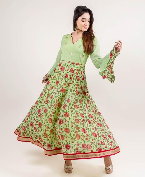 You would fall in love with this elegant embroidered Long anarkali dress. With all its twirls and swirls, this dress is adorned with gotta pati embroidery, jaal print, side zipper, fancy lace trim, double layered bell sleeves and fancy neckline that is sure to satisfy your cravings for a feminine yet fun look.