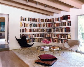 Elle Decor... comfy reading room with great shelves for book storage.