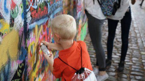 Let your children go wild on Lennon's wall in Prague. Family travel Prague I Prague Lennon Wall I Prague with kids