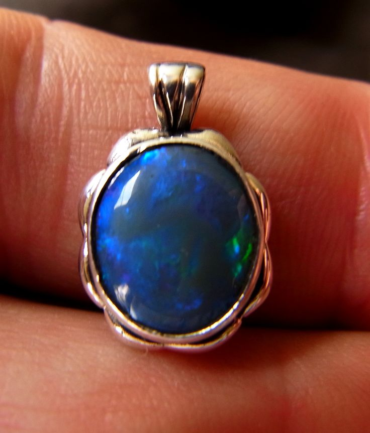 Just sold to Indiana U.S.A.this 1.75 carat Solid black Opal in a Sterling Silver Pendant Setting. All Cut, polished and set by 'Yours truly! www.gemniopals.com.au and go to 'Online Store' for other great items for sale.