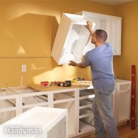 DIY Step by Step   Kitchen Cabinet Installation, except install the uppers before the lowers!  It's much easier to handle the cabinets with nothing in your way.