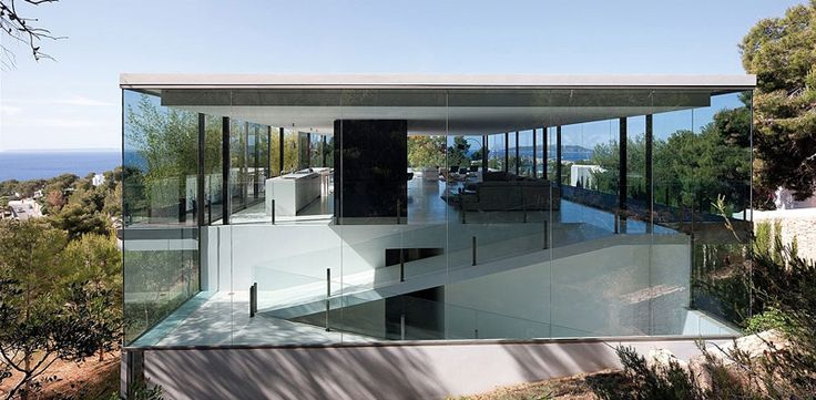 Transparent house in Baleares - AABE - Atelier d'Architecture Bruno Erpicum & Partners A butterfly conservatory, the key thrown away: a space defined by the transparency of the windows, an infinite space where thoughts take flight at the whim of imagination.