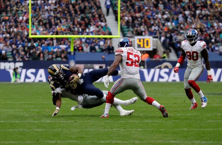 Giants vs. Rams in London:     October 23, 2016  -   17-10, Giants  -  Los Angeles Rams running back Todd Gurley (30) is tackled during an NFL game between the New York Giants and the Los Angeles Rams at Twickenham Stadium in London, Sunday Oct. 23, 2016.