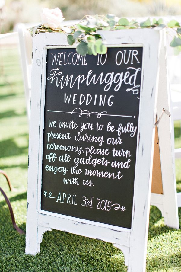 unplugged ceremony sign - photo by Pinkerton Photography http://ruffledblog.com/spring=romantic-wedding-in-the-desert