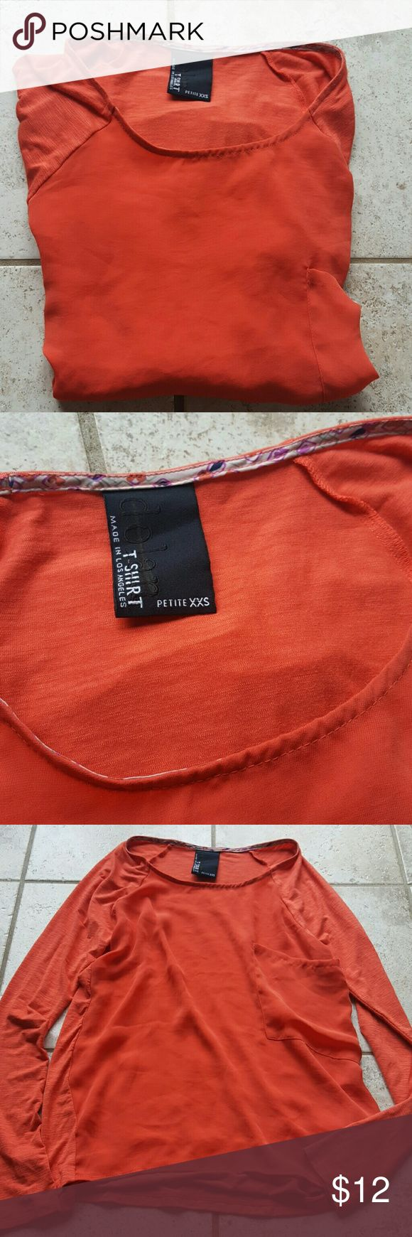 Dolan long sleeve top New without tags. Size petite extra extra small. Dolan t-shirt. Made in Los Angeles. Really pretty dark oranges red color. Self is 95% rayon and 5% spandex. Contrast is 100% polyester. Does have a line across the brand name on the label. Approximately 17 inches across the chest armpit to armpit laying flat and 23 inches in length. Anthropologie Tops Tees - Long Sleeve
