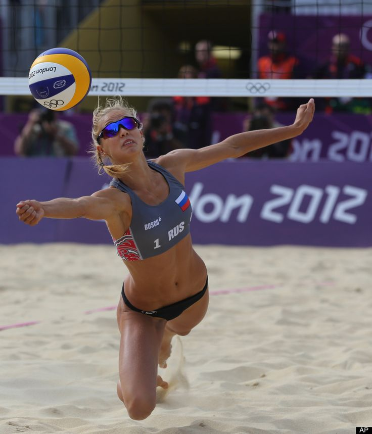 Anastasia Vasina from Russia dives for a ball during the Beach Volleyball match against China at the 2012 Summer Olympics, Saturday, July 28, 2012, in London