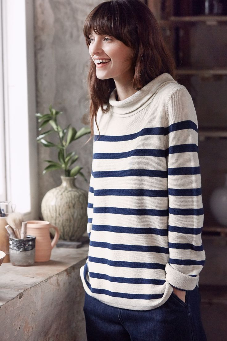 Our Between Tides Jumper is a spring/summer version of our popular Gulf Jumper. Inspired by styles from the 1950s, this flattering fine knit has engineered nautical stripes, long sleeves and an elegant Hepburn neckline. A versatile style that looks equally good with skirts as it does trousers.