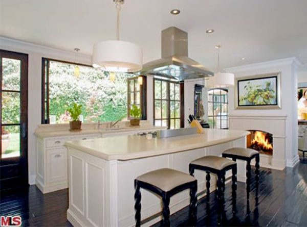 Love the dark hardwood floors, fireplace and bi-fold windows in Kim Kardashian's beautiful kitchen.