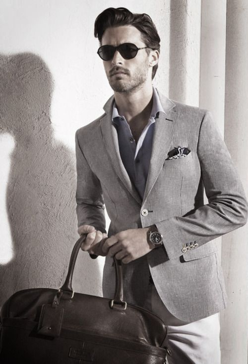 love this mixed matched suit look. lighter gray trousers from a suit with a darker gray jacket from a suit! nice way to use your cloths to the max!