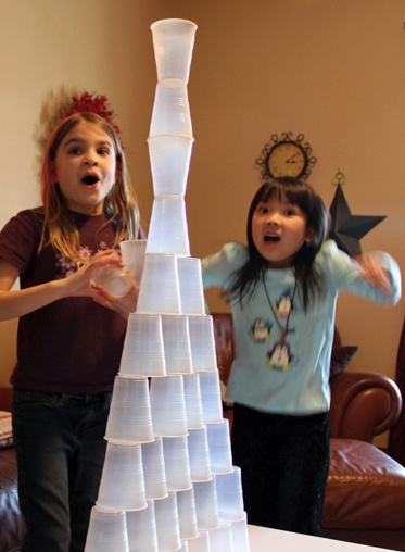 Cup Stacking Game for Kids- I just played this with the neighborhood girls (ages 8-10) and they were completely entertained. My name is Michelle LeMieux and I approve this pin ;)