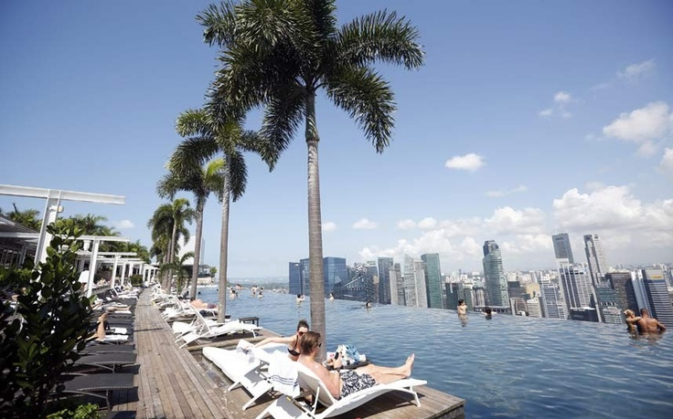 Guests enjoy the view from the infinity pool of the Marina Bay Sands hotel in Singapore. The Port of Singapore was crowned the 'Best Seaport in Asia' for an unprecedented 25th time during an industry awards ceremony.