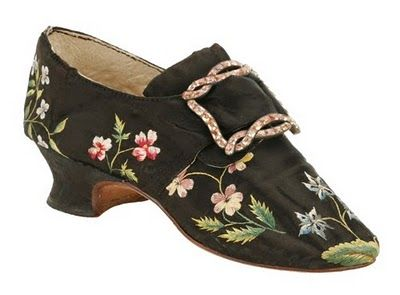1760s turn shoes of black satin seem a lighter more modern shoe with fresh sprigs of heartsease and periwinkle-like flowers stitched in worsted or crewel wool.