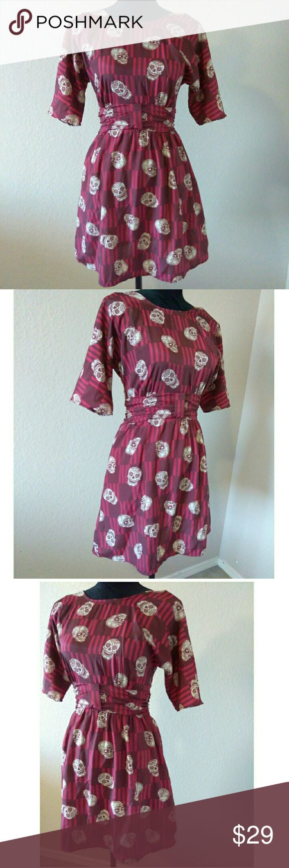 Maroon Retro Inspired Sugar Skull Dress Cute maroon sugar skull dress. Definitely retro inspired but modern aged. Brand is Xhiliration. Size XS. 100% Polyester. Approx measurements are 16 inches chest, 12 inches waist, 32.5 inches length. Great Condition. Xhilaration Dresses