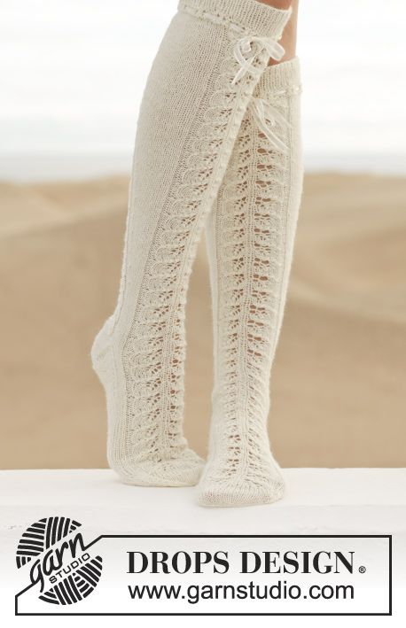 """Knitted DROPS knee socks with lace pattern in """"Fabel"""". ~ Free DROPS Design via http://www.garnstudio.com/lang/us/pattern.php?id=6528&lang=us."""
