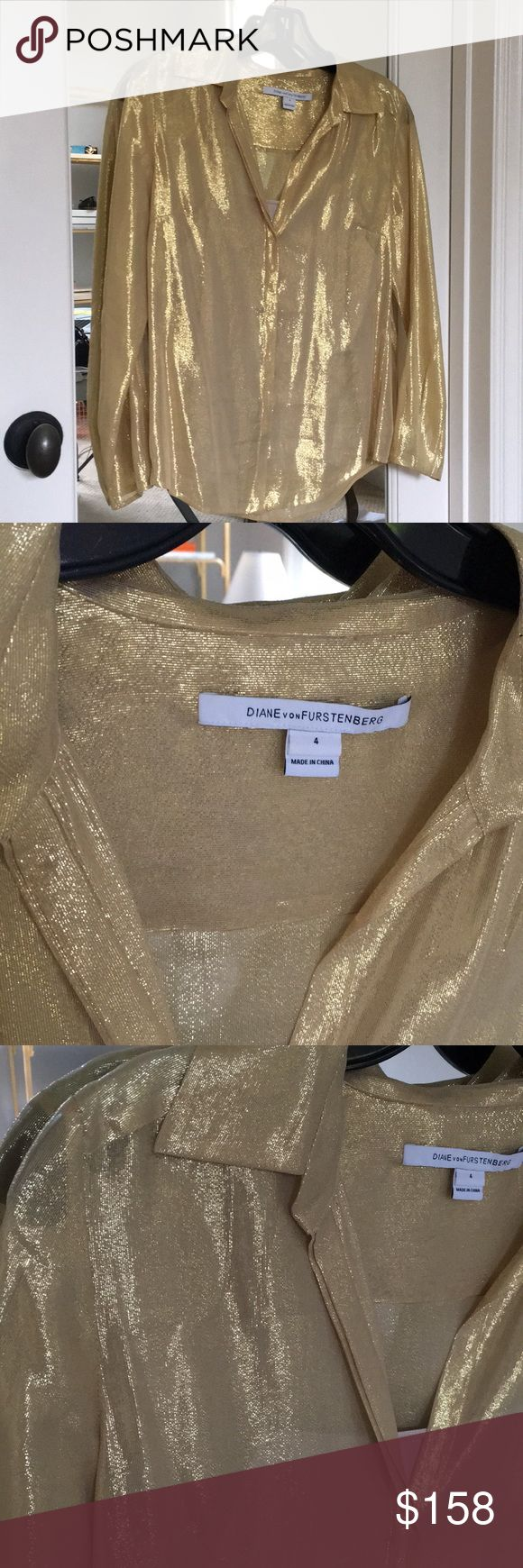 Diane von Furstenberg gold top Button down with a detachable nude cami. 70% silk, 30% metallic. Shoulder to shoulder is 15 inches, length of sleeve is 22 inches, armpit to armpit is 19 inches and from shoulder to hem is 24 inches. Diane Von Furstenberg Tops Button Down Shirts